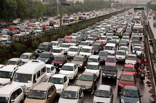© A traffic jam following power outage and rains at the Delhi-Gurgaon road on the outskirts of New Delhi, India, Tuesday, July 31, 2012.