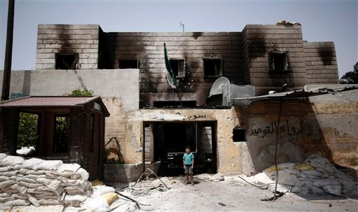 © In this Sunday, July 29, 2012 photo, a Syrian boy stand in the rubble of a destroyed police station at the border town of Azaz, some 20 miles (32 kilometers) north of Aleppo, Syria.