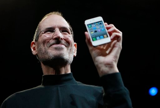 FILE - In this June 7, 2010, file photo, Apple CEO Steve Jobs holds a new iPhone at the Apple Worldwide Developers Conference in San Francisco. (AP Photo/Paul Sakuma, File)