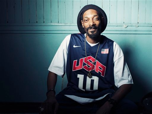 This Monday, July 30, 2012 photo shows Snoop Dogg, who now goes by Snoop Lion, posing for a portrait at Miss Lily's in New York.