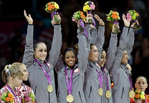 U.S. gymnasts, top left to right, Jordyn Wieber, Gabrielle Douglas, McKayla Maroney, Alexandra Raisman and Kyla Ross raise their hands and celebrate during the medal ceremony of the Artistic Gymnastics women's team final at the 2012 Summer Olympics. (AP)