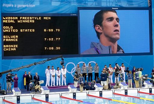 United States' Michael Phelps is seen on a large screen during a medal ceremony for the French, United States and Chinese men's relay teams in the 4 x 200-meter freestyle relay at the Aquatics Centre in the Olympic Park. (AP Photo/Lee Jin-man)