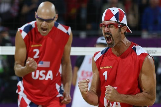 Todd Rogers, right, and Phil Dalhausser, left, of US celebrate after defeating Spain in their Beach Volleyball match at the 2012 Summer Olympics, Tuesday, July 31, 2012, in London. (AP Photo/Petr David Josek)