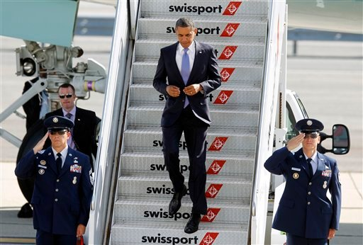 President Barack Obama arrives at John F. Kennedy International Airport, Monday, July 30, 2012, in New York. (AP Photo/Jason DeCrow)