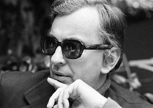 FILE - In this Dec. 9, 1974 file photo, author Gore Vidal tosses barbs in all directions as he discusses Hollywood unions, politics, lecturing and publicizing books during an interview in Los Angeles. (AP File Photo)