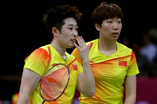 China's Yu Yang, left, and Wang Xiaoli talk while playing against Jung Kyun-eun and Kim Ha-na, of South Korea, in a women's doubles badminton match at the 2012 Summer Olympics, July 31, 2012. (AP Photo/Andres Leighton)