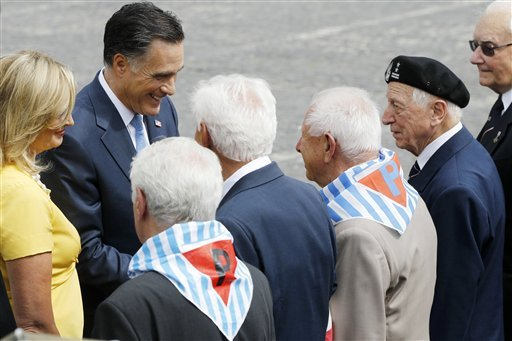 Republican presidential candidate, former Massachusetts Gov. Mitt Romney, and wife Ann greet veterans and survivors after visiting the Memorial of the Warsaw Uprising in Warsaw, Poland, Tuesday, July 31, 2012. (AP Photo/Charles Dharapak)