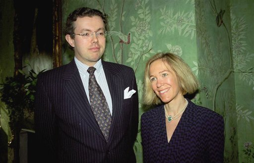Nov. 26, 1996 file: Eva Rausing and her husband Hans Kristian Rausing at Winfield House, London, the residence of the US ambassador to the UK attending the Glamour America Fashion Show and lunch. (AP Photo/Alan Davidson/The Picture Library Ltd, File)