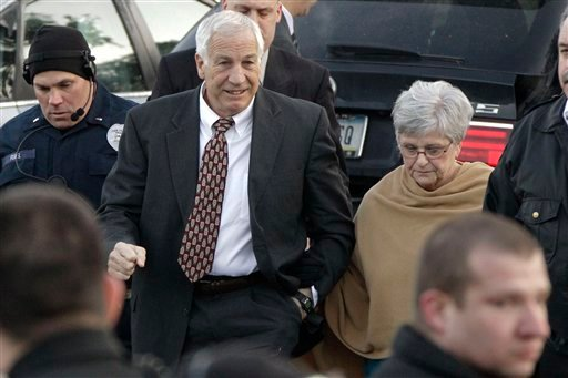 FILE - In this Dec. 13, 2011, file photo, former Penn State assistant football coach, Jerry Sandusky, center, arrives with his wife, Dottie Sandusky, right, for a preliminary hearing at the Centre County Courthouse in Bellefonte, Pa. (AP Photo)