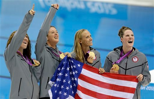 From right, United States' Missy Franklin, United States' Dana Vollmer, United States' Allison Schmitt and United States' Shannon Vreeland pose with their gold medals for the women's 4x200-meter freestyle relay swimming final. (AP Photo/Lee Jin-man)