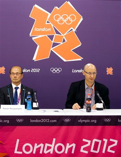 Chief Operating Officer Thomas Lund, right, and Deputy President Paisan Rangsikitpho, of the Badminton World Federation, appear during a news conference announcing the elimination of eight female badminton doubles players at the 2012 Summer Olympics.