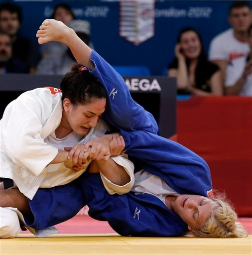 Kayla Harrison of the United States competes against Mayra Aguiar of Brazil (in white) during the women's 78-kg judo competition at the 2012 Summer Olympics.