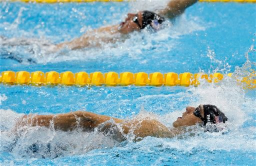 United States' Michael Phelps leads compatriot Ryan Lochte in the men's 200-meter individual medley swimming final at the Aquatics Centre in the Olympic Park during the 2012 Summer Olympics.