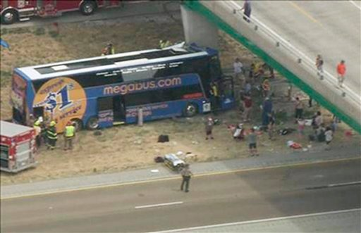 In this photo from video provided by KSDK-TV NewsCenter5 in St. Louis, first responders work the scene of a charter bus crash on Interstate 55 near Litchfield, Ill. Thursday, Aug. 2, 2012. (AP Photo/Courtesy KSDK-TV NewsCenter5 in St. Louis)