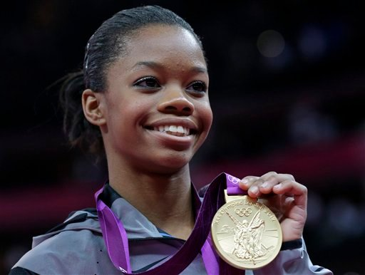 U.S. gymnast Gabrielle Douglas displays her gold medal during the artistic gymnastics women's individual all-around competition at the 2012 Summer Olympics.