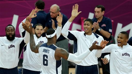 United States' Lebron James (6) celebrates with teammates during a men's basketball game against Nigeria at the 2012 Summer Olympics, Thursday, Aug. 2, 2012, in London. (AP Photo/Charlie Riedel)