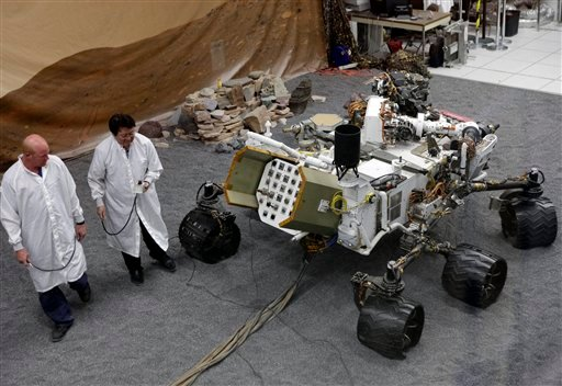 Engineers work on a model of the Mars rover Curiosity at the Spacecraft Assembly Facility at NASA's Jet Propulsion Laboratory in Pasadena, Calif.