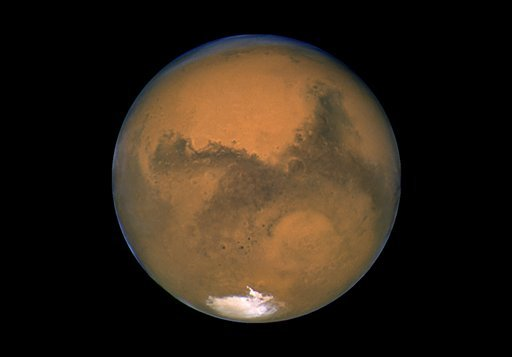 This Aug. 26, 2003 image made available by NASA shows Mars photographed by the Hubble Space Telescope on the planet's closest approach to Earth in 60,000 years. (AP Photo/NASA)