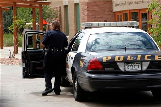 A University of Colorado Police officer gets into her patrol car on Thursday, Aug. 2, 2012, at the University of Colorado Medical Campus in Aurora, Colo. (AP Photo/Ed Andrieski)