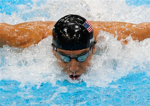 © United States' Michael Phelps swims in the men's 4 X 100-meter medley relay at the Aquatics Centre in the Olympic Park during the 2012 Summer Olympics in London, Saturday, Aug. 4, 2012.
