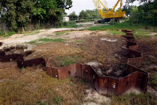 © This is a July 31, 2012 photograph of a small plot near the former President Broadwater Beach Golf Club in Biloxi, Miss., that the Harrison County Utility Authority spent only $25, 200 so they can locate a sewage pump station.