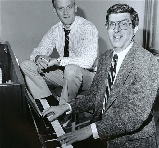 FILE - This Sept. 9, 1986 file photo shows composer Marvin Hamlisch, right, at the piano with lyricist Howard Ashman in New York.