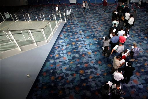 FILE - In this June 13, 2012 file photo, job seekers wait in line at a job fair expo in Anaheim, Calif. (AP Photo/Jae C. Hong, File)