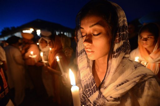 Ruby Singh,22, of Long Grove, Ill., participates during a prayer vigil at the Sikh Religious Society temple in Palatine, Ill. on Monday, Aug. 6, 2012. (AP photo / Daily Herald, Mark Welsh)
