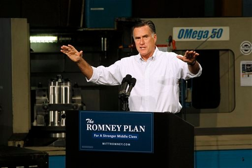 This photo taken Aug. 7, 2012 shows Republican presidential candidate, former Massachusetts Gov. Mitt Romney campaigning in Elk Grove Village, Ill. (AP Photo/Charles Dharapak)