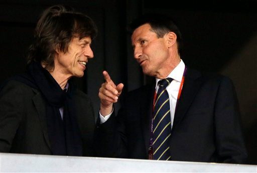 Musician Mick Jagger, left, and Sebastian Coe, chairman of the London 2012 Organising Committee for the Olympic Games attend an evening session of athletics in the Olympic Stadium at the 2012 Summer Olympics, London, Monday, Aug. 6, 2012. (AP Photo)
