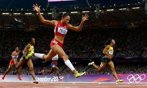 United States' Allyson Felix, second from right, crosses the finish line to win gold ahead of Jamaica's Shelly-Ann Fraser-Pryce, right, in the women's 200-meter final during the athletics in the Olympic Stadium at the 2012 Summer Olympics. (AP Photo)