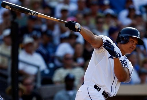 San Diego Padres' Will Venable hits a double down the right field line against the Chicago Cubs and drives in Chase Headley during the second inning of a baseball game on Wednesday, Aug. 8, 2012, in San Diego.