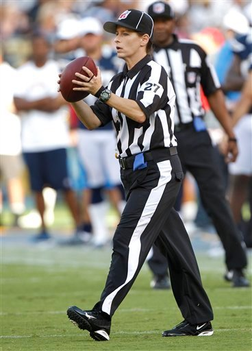Line judge Shannon Eastin works the field during an NFL preseason football game between the San Diego Chargers and the Green Bay Packers, Thursday, Aug. 9, 2012, in San Diego. Eastin is a replacement official making her NFL debut in the exhibition game.