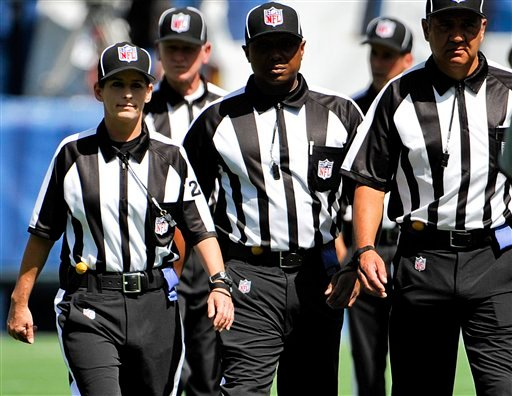 Line judge Shannon Eastin, left, takes the field prior to an NFL preseason football game between the San Diego Chargers and the Green Bay Packers, Thursday, Aug. 9, 2012, in San Diego.