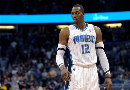FILE -This file photo taken March 13, 2012, shows Orlando Magic center Dwight Howard during an NBA basketball game in Orlando, Fla. (AP Photo/Phelan M. Ebenhack, file)