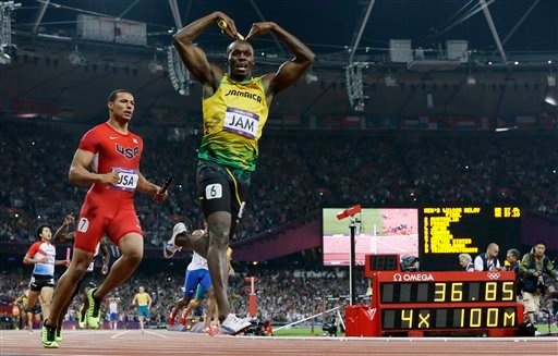 © Jamaica's Usain Bolt celebrates his win in the men's 4 x 100-meter relay final during the athletics in the Olympic Stadium at the 2012 Summer Olympics, London, Saturday, Aug. 11, 2012. Jamaica set a new world record with a time of 36.84 seconds.