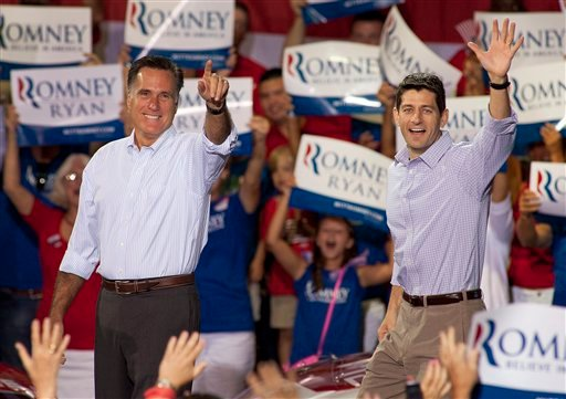 © Republican presidential candidate Mitt Romney, left, and his vice presidential running mate Rep. Paul Ryan, R-Wis., arrive at a campaign rally Sunday, August 12, 2012 in Mooresville, N.C. at the NASCAR Technical Institute.