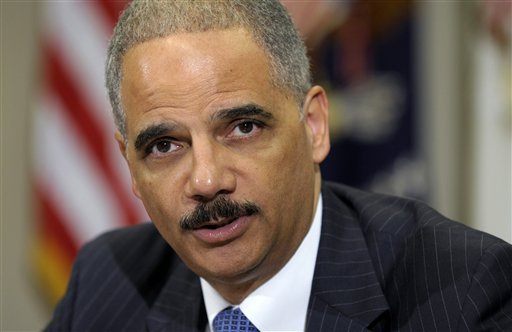 In this July 26, 2012 file photo, Attorney General Eric Holder speaks in the Cabinet Room of the White House in Washington. (AP Photo/Susan Walsh, File)