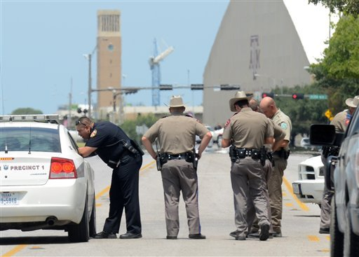 Texas State troopers and Brazos Valley lawmen work the scene of the shooting of two fellow law officers, Monday, Aug. 13, 2012 in College Station, Texas. (AP Photo/College Station Eagle, Dave McDermand)