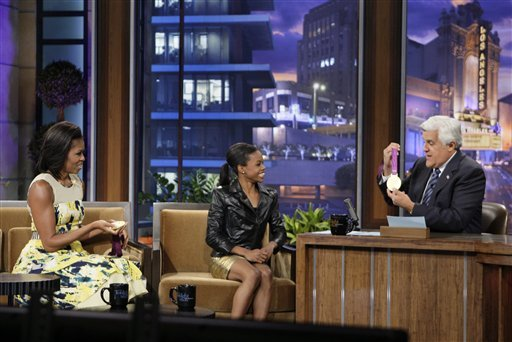 """© This Monday, Aug. 13, 2012 photo released by NBC shows first lady Michelle Obama, left, olympic gold medalist Gabby Douglas and host Jay Leno during a taping of """"The Tonight Show with Jay Leno,"""" in Burbank, Calif."""