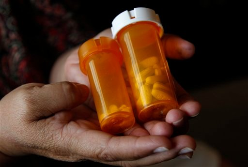 © Sandra Pico, 52, holds medications she takes, at her home in North Miami Beach, Fla., Thursday, July 26, 2012.