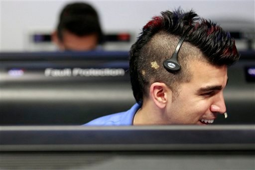 FILE -In this Sunday Aug. 5, 2012 file photo, flight director for the Mars rover Curiosity Bobak Ferdowsi, who cuts his hair differently for each mission, works inside the Spaceflight Operations Facility for NASA's Mars Science Laboratory Curiosity rover.