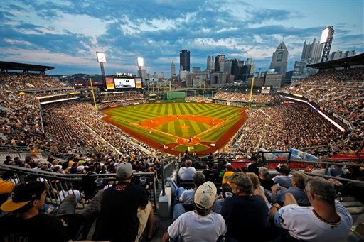 The Pittsburgh Pirates play a baseball game against the San Diego Padres as the sun sets on a crowd of baseball fans at PNC Park in Pittsburgh, Friday, Aug. 10, 2012.