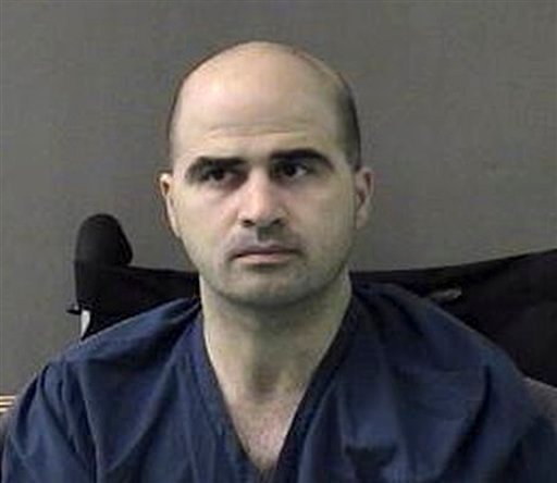 An April 9, 2010 file photo provided by the Bell County Sheriffs Department, shows U.S. Maj. Nidal Hasan at the San Antonio to Bell County Jail in Belton, Texas. (AP Photo/Bell County Sheriffs Department, File)