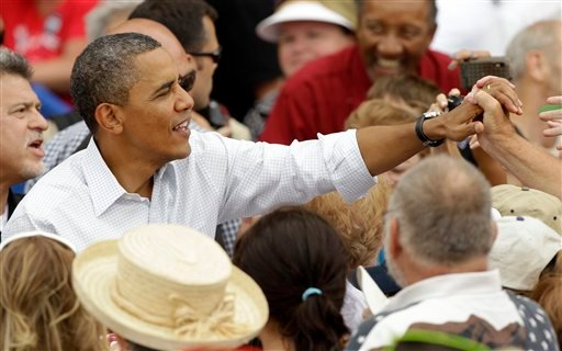 President Barack Obama greets supporters during a campaign stop at the Alliant Energy Amphitheater, Wednesday, Aug. 15, 2012, in Dubuque, Iowa. The president is on a three-day campaign bus tour through the state. (AP Photo/Charlie Neibergall)