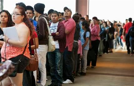 Young immigrants stand in a long line at Chicago's Navy Pier on Wednesday, Aug. 15, 2012, for guidance with a new federal program that would help them work legally in the United States and avoid deportation. (AP Photo/Sitthixay Ditthavong)