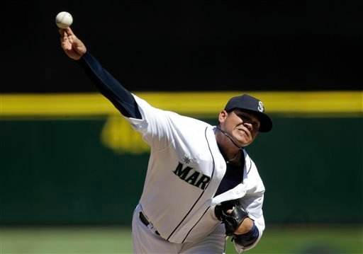 Seattle Mariners starting pitcher Felix Hernandez throws to a Tampa Bay Rays batter in the fourth inning of a baseball game, Wednesday, Aug. 15, 2012, in Seattle. (AP Photo/Ted S. Warren)