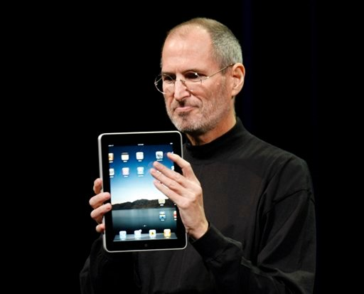 © FILE - In this Jan. 27, 2010 file photo, Apple CEO Steve Jobs shows off the new iPad during an event in San Francisco.