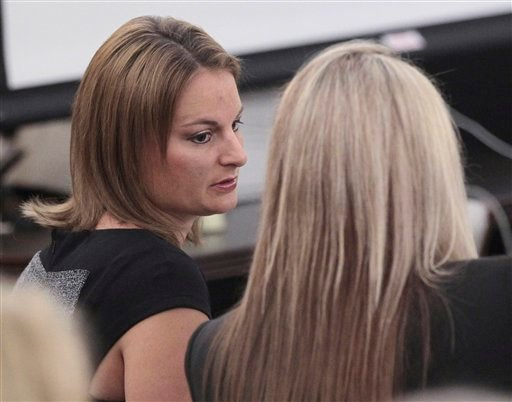 Brittni Colleps speaks with a defense lawyer during her trial in Fort Worth, Texas on Tuesday, Aug. 14, 2012. (AP Photo/The Fort Worth Star-Telegram, Ron T. Ennis)