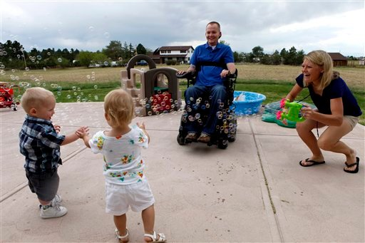 © This photo taken Aug. 2, 2012, shows the Keil family playing with a bubble machine at their home near Parker, Colo. From left are; Matthew Jr., Faith, Matthew and Tracy.